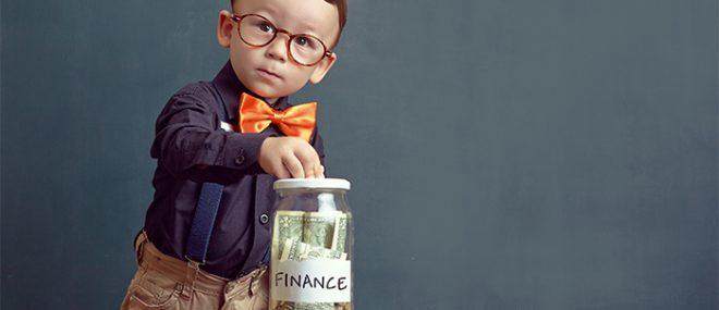 child putting money in a jar