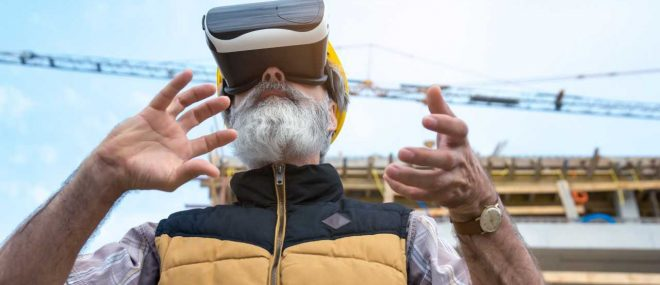 man with VR headset on construction site.