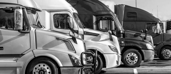 A fleet of trucks parked next to each other