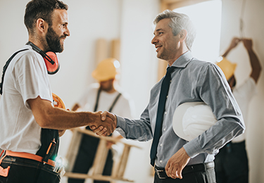A contractor and surety bondsman shaking hand